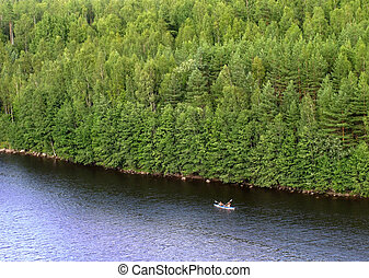 boat cruise - cruising canoe and wall of coastal forest