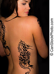 Sexy women and dragon tribal tattoo - A high resolution...