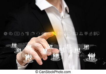 Business Network - Man touching a business network interface...