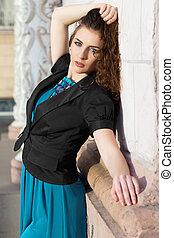 Brunette wearing blue dress