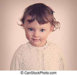 Smiling beauty child girl face. Closeup vintage portrait
