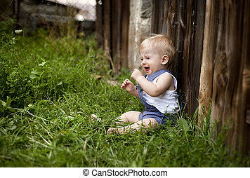 Family on the farm - A little boy being uncomfort and...