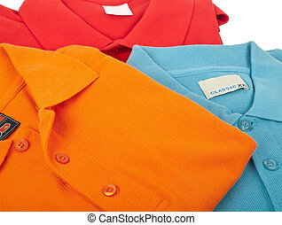 Polo shirts - pile of man polo shirts on white