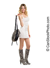 Joyful young woman dressed in the colors of zebra boots....