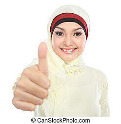 young muslim woman showing thumb up - young muslim woman in...
