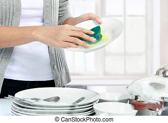 washing dishes - close up hands of Woman Washing Dishes in...
