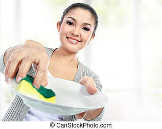 washing dishes - Happy Young Woman Washing Dishes in the...