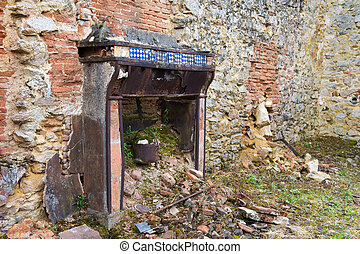 Broken house in Oradour sur Glane - Interior of broken house...