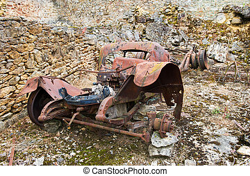 Rusty old car Oradour sur Glane - leaved car in Destroyed...