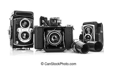 Collection old well worn vintage film camera on white background