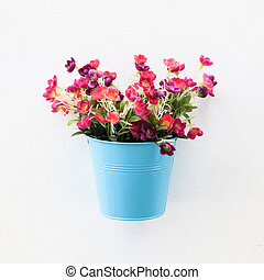 Colorful flowerpot on  the white wall
