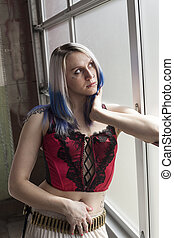 Beautiful Young Goth Woman with Blue Hair and Red Corset -...
