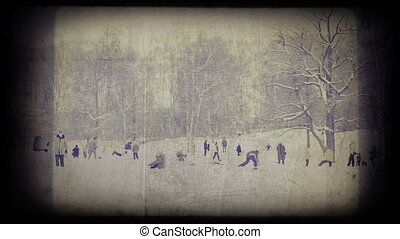 Timelapsed vintage winter scenic of groups of people playing...
