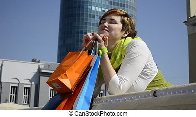 young woman resting on shopping
