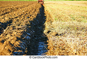 Plowing - Two parts of field-before and after plowing ,and...