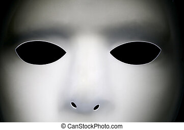 White Mask Close Up - White alien looking face with big...