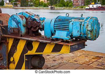Old motor electric - Old rusty electric motor with a large...