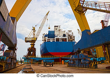 Shipyard Scenery - Ship and monumental crane in the...