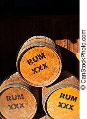 Three Rum Barrels - Wooden Rum barrels ringed with metal...