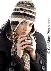 woman with winter cap holding coffee mug on an isolated...