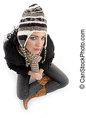 high angle view of woman wearing winter cap against white...