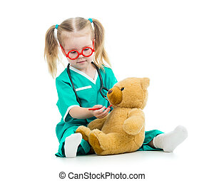 child girl dressed as doctor playing with toy - child girl...