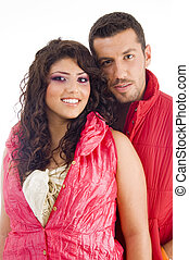 young couple standing in front of camera