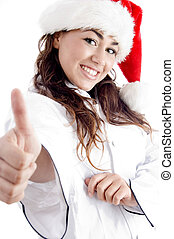 smiling young chef showing thumbs up and wearing red christmas hat on an isolated white background