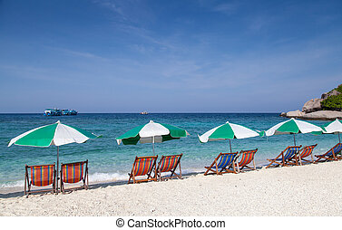 colorful beach chair with sun umbrella