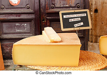 Chunk of cheese with price at outdoor market in France