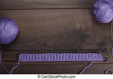 knitting needles and balls of threads background - knitting...