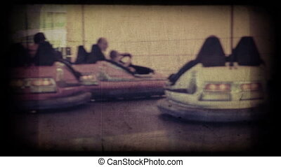 Bumper carnival cars. Defocused shot with unrecognizable...