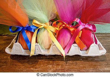 Easter eggs with ribbon - Easter eggs wrapped in tulle with...