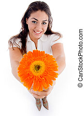 high angle view of woman showing flower with white...