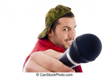 male singer showing microphone