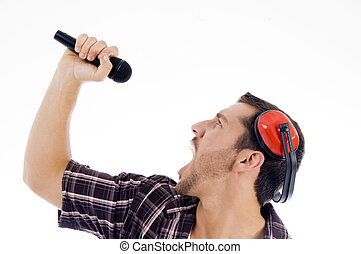 male singing loudly on microphone