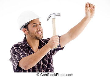 engineer in action with hammer