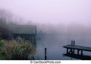 lake bank - a foggy landscape on a october morning