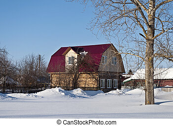 Wooden house with a loft in winter time - New log house with...