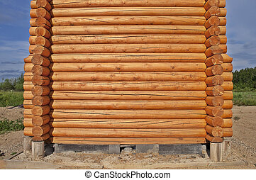 Log cabin construction - New log wooden house construction...