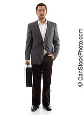 handsome businessman standing with his office bag on an...