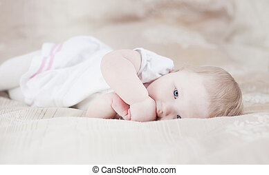 Cute baby having fun on a bed