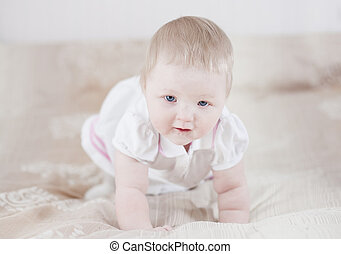 Cute baby having fun - Lying on a bed