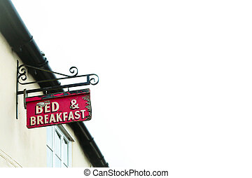 Bed and breakfast sign on a traditional english cottage with...