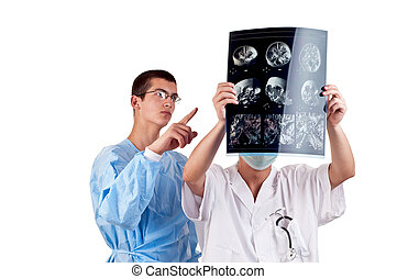 portrait of two doctors examining a tomography
