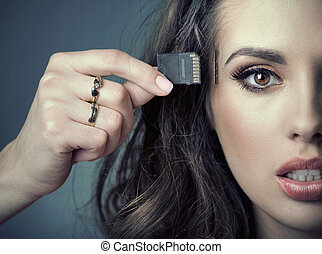 Sensual woman inserting card into her head - Beautiful woman...