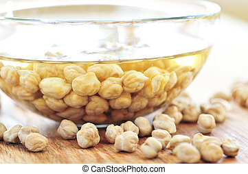 Chickpeas - Dry raw chickpeas soaking in water before...