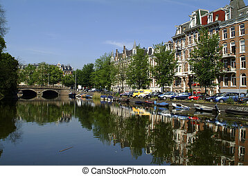 Netherlands, Amsterdam, singel gracht canal and homes with...