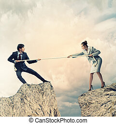 People pull the rope - Confrontation between two business...