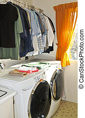 Laundry room with modern washer and dryer